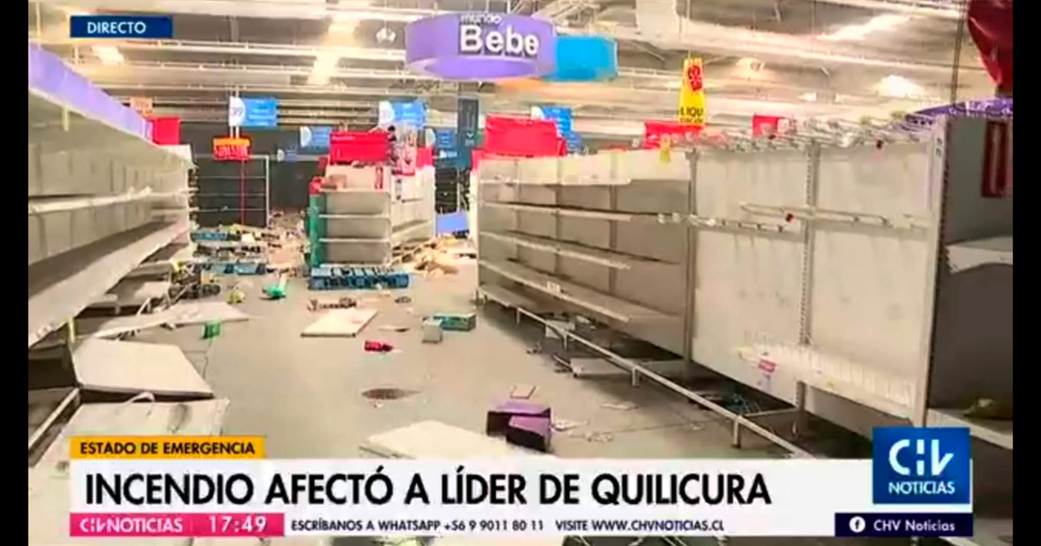 Empty store shelves in a looted shop